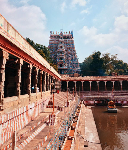 Meenakshi Amman Temple, located on the southern bank of the Vaigai River in the temple city of Madurai,